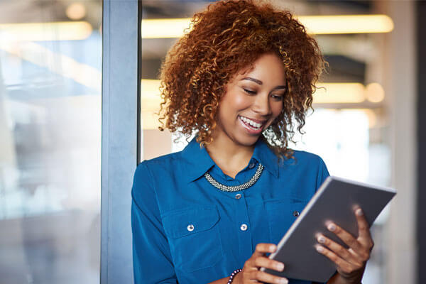 Business woman using client application with ease in office