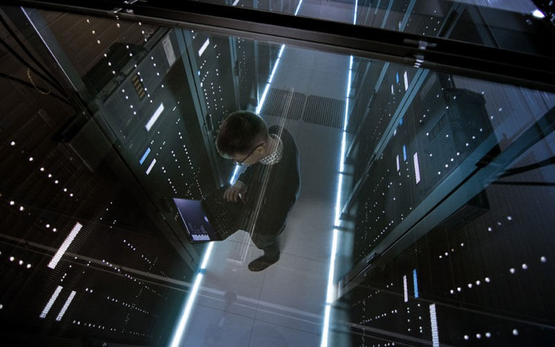Overhead view of IT technician working in modern data center